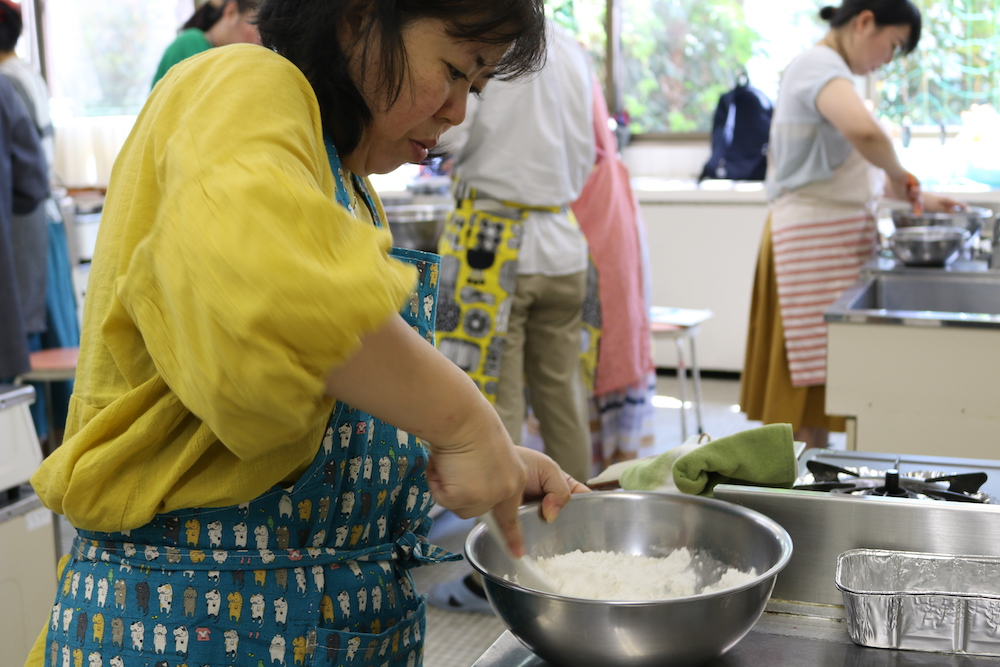 a student mixing rice flour