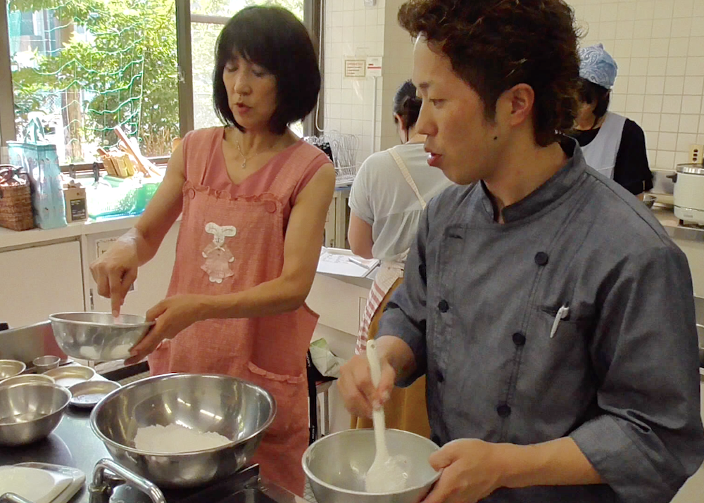 Katayama teaching how to mix the flour